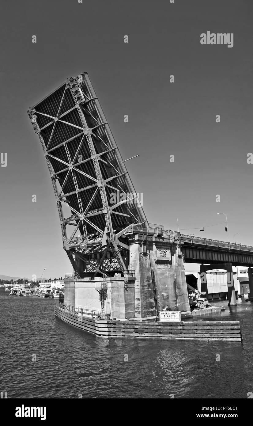 This is the Fremont drawbridge in Seattle, WA, lifted up from Lake Union perspective.  It's a steel double-leaf bascule bridge that is a major transpo - Stock Image