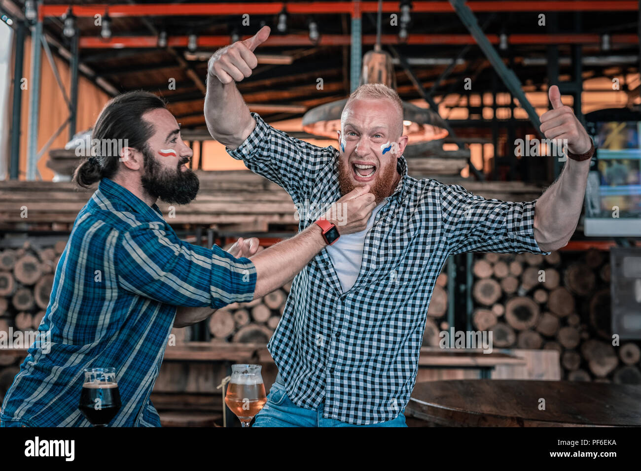One of friends being happy after watching football game together - Stock Image