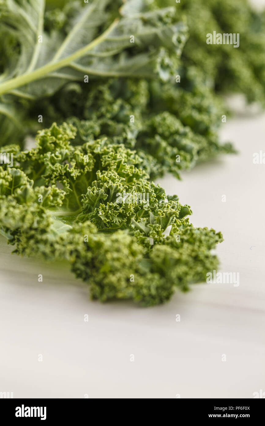 Fresh green leaves of kale on white background. Clean eating concept. - Stock Image