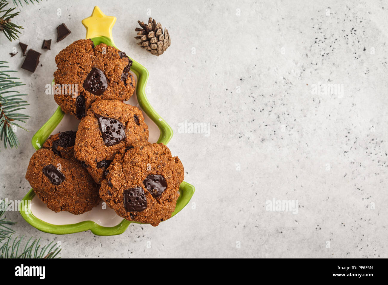 Christmas cookies with chocolate in christmas plate, white ...
