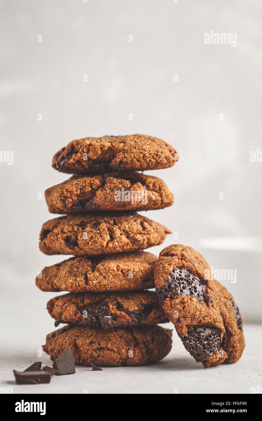 Stack of healthy vegan cookies with chocolate. Clean eating concept. Stock Photo