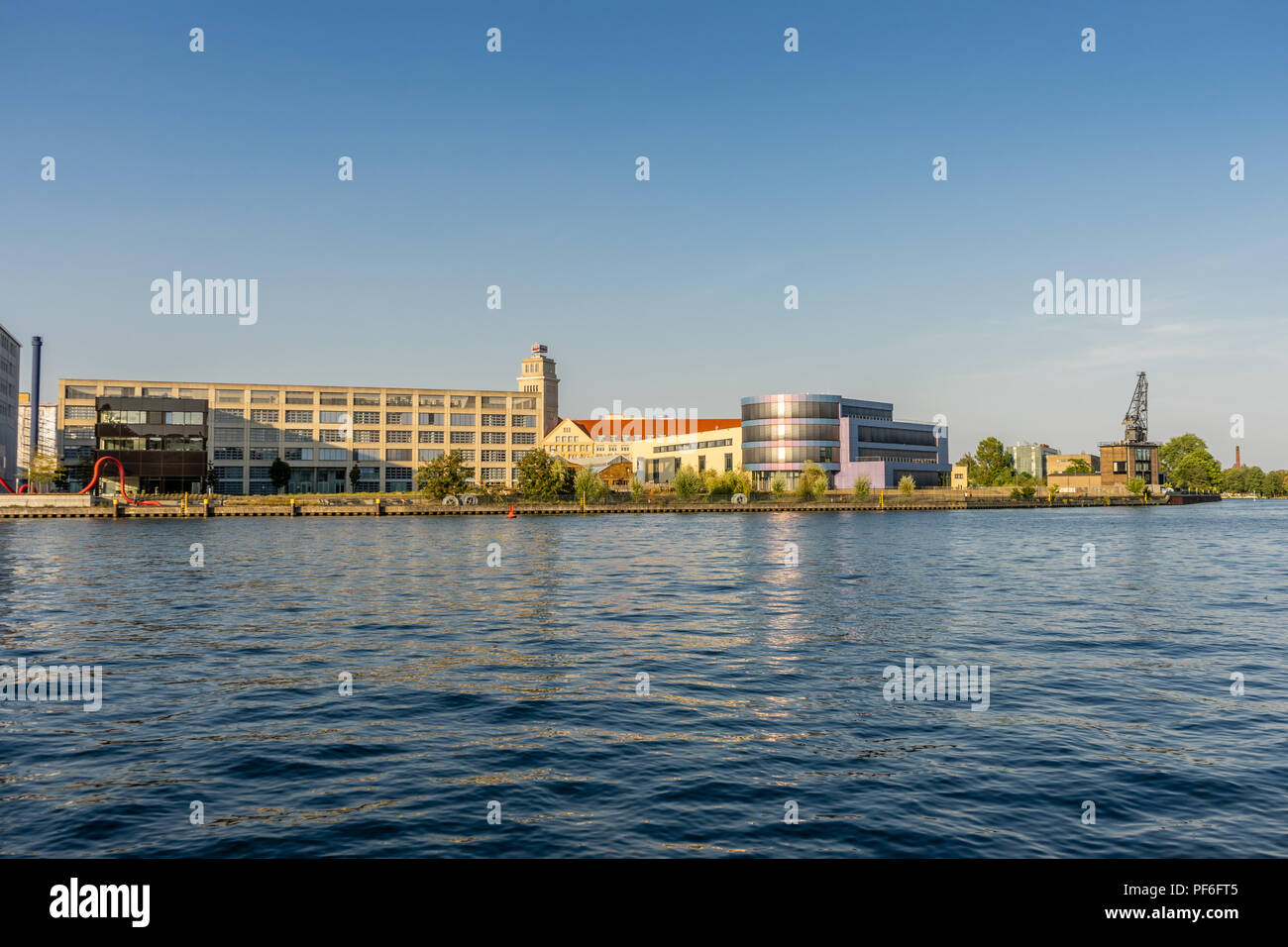 View across the river Spree to the University of Applied Sciences ( Hochschule für Technik und Wirtschaft - HTW) in summer 2018, Berlin, Germany - Stock Image