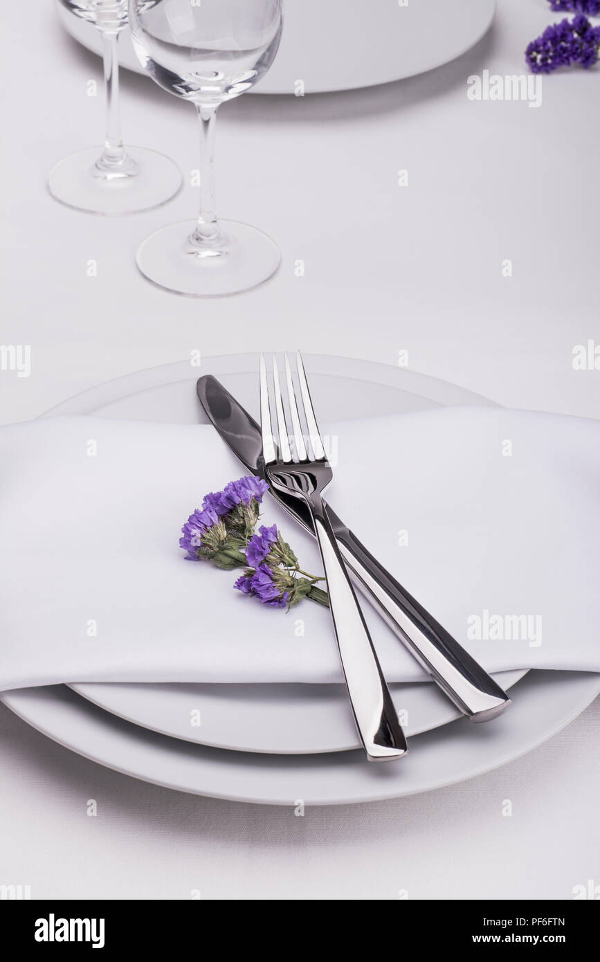 Table set with flowers on white Stock Photo