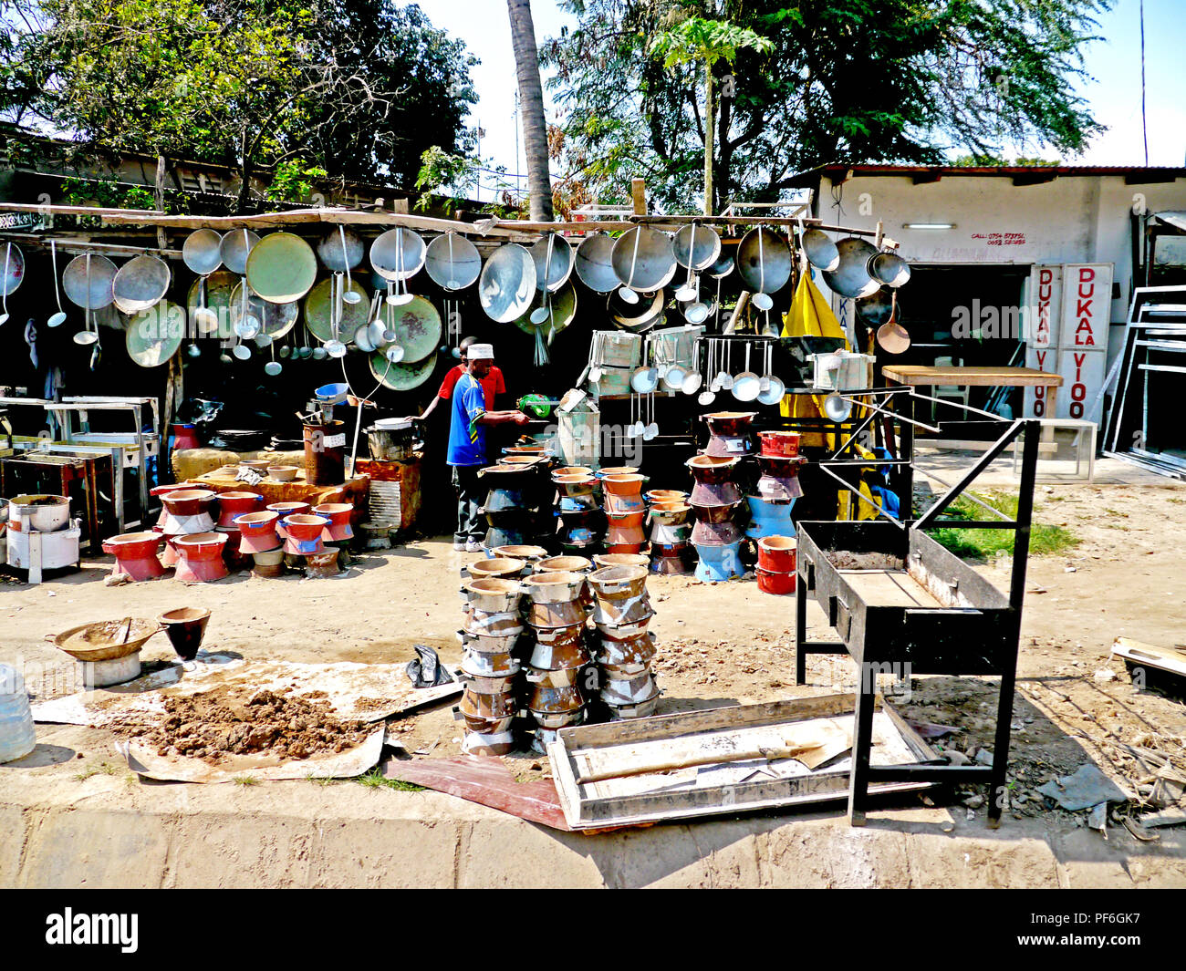 A street market for pots, pans and kitchen equipment by the roadside in Dar es Salaam, Tanzania, Africa - Stock Image