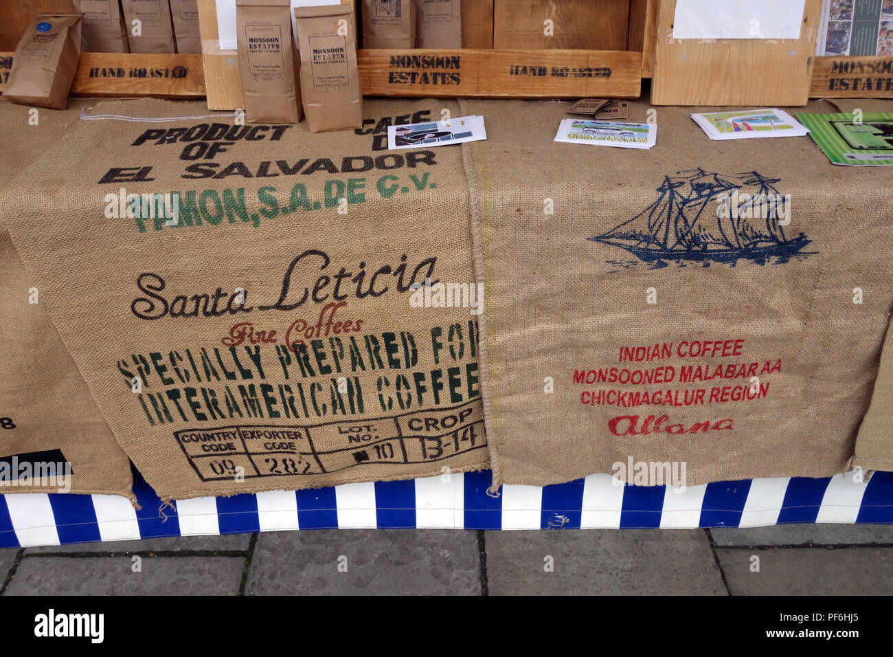 Super old coffee sacks  on display at a Weekly Saturday market with many stalls is held in Warwick town centre, Warwickshire, England - Stock Image