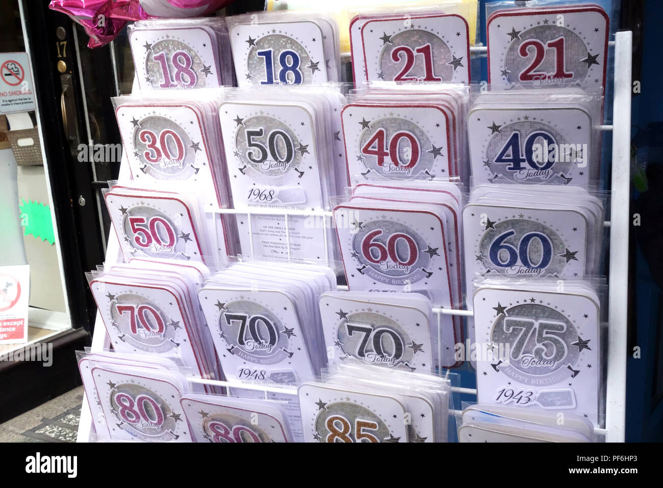 Age is just a number Birthday Cards with different ages in numbers on front of card. 18 to 90 Birthday Cards in shop display on a street frontage - Stock Image