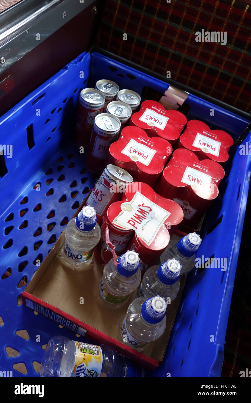 Cans of pre mixed Pimms drink and soft drinks on a wedding party bus for guests - Stock Image