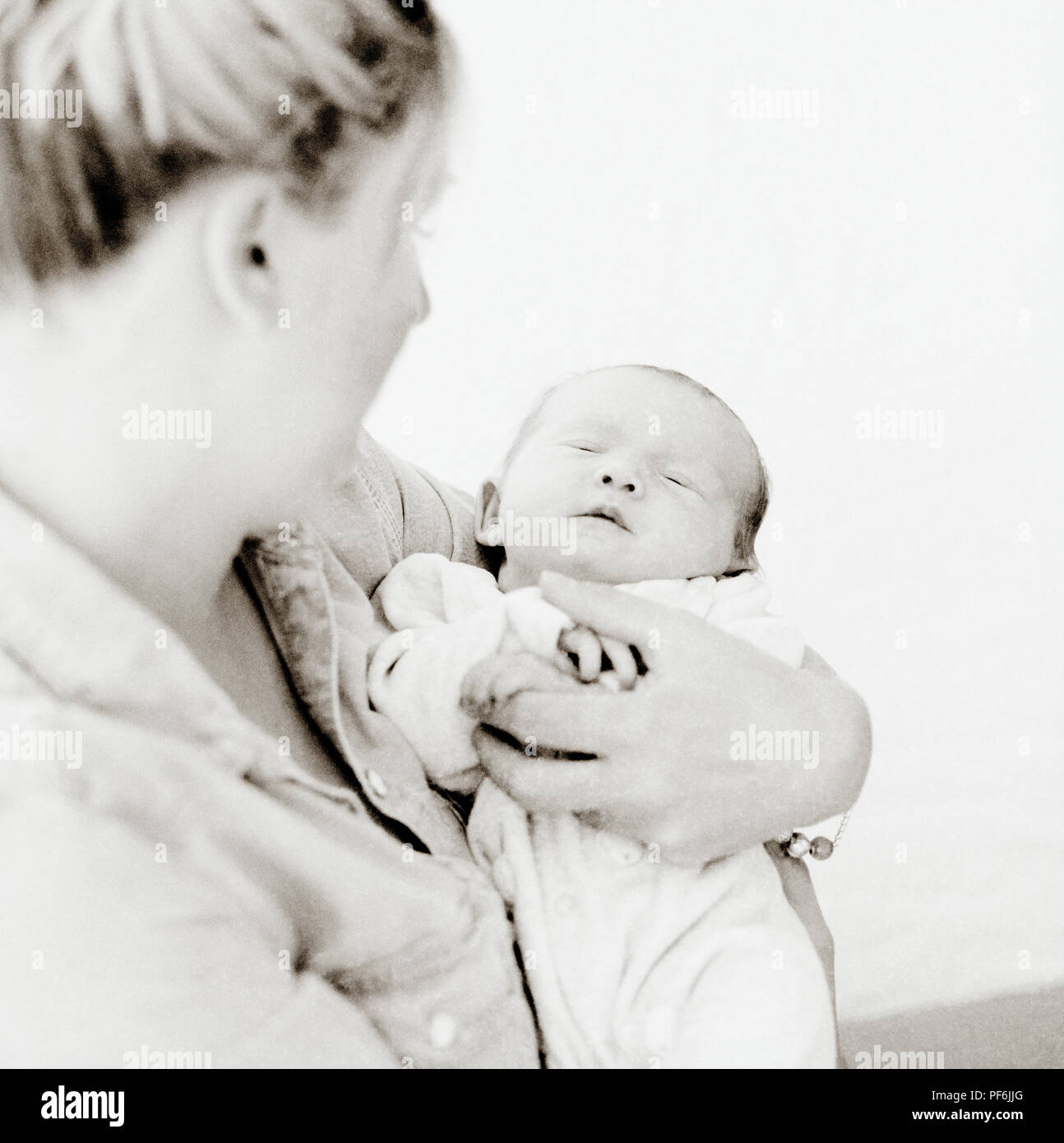 Lifestyle Photography - Mother Claire with new born baby Lucy Francesca. British English White Caucasian - Stock Image