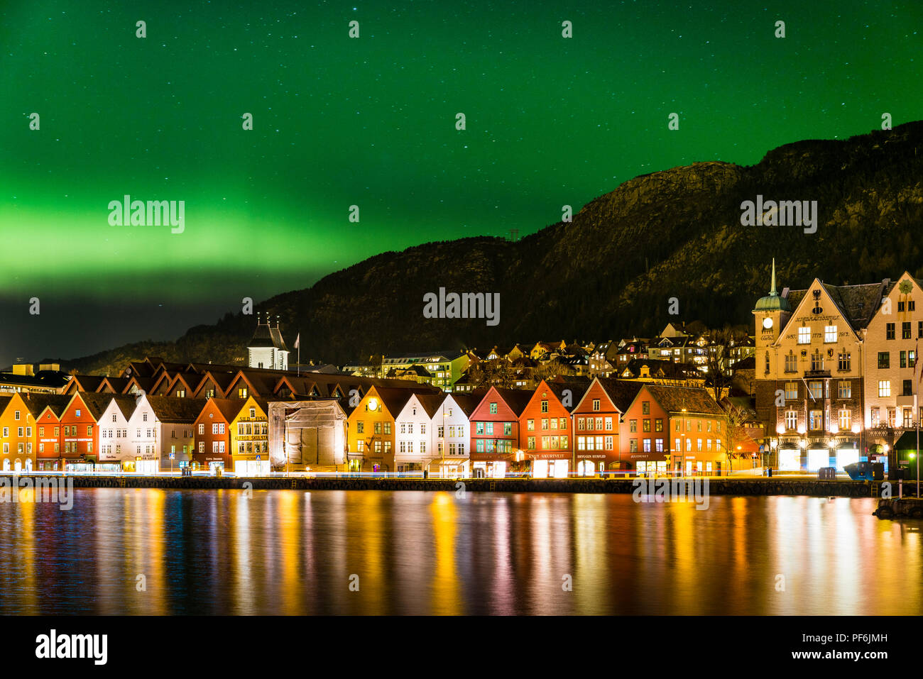 Northern Lights over the historical buildings on Bryggen in Bergen, on the Unesco world heritage list. - Stock Image