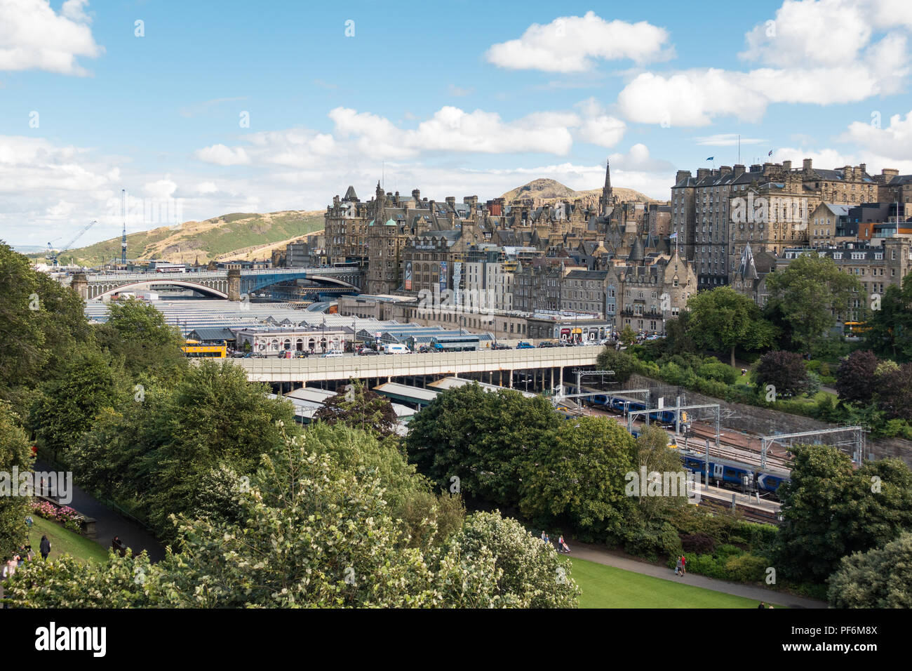Edinburgh Waverley Station, old town and Arthurs Seat, Edinburgh, Scotland, UK - Stock Image