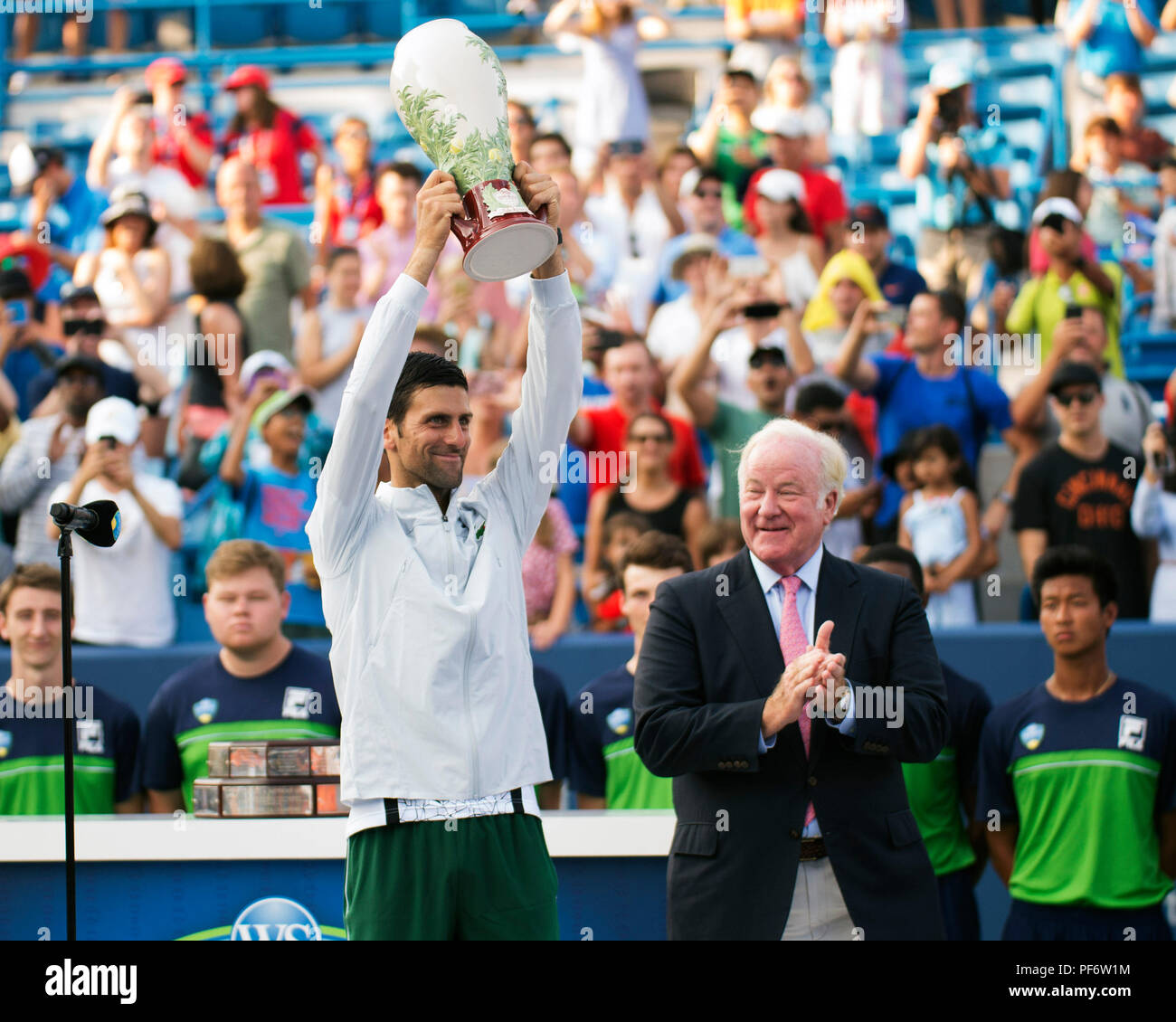 Mason, Ohio, USA. August 19, 2018: Novak Djokovic (SRB) holds aloft the Rookwood Trophy at the Western Southern Open in Mason, Ohio, USA. Brent Clark/Alamy Live News - Stock Image