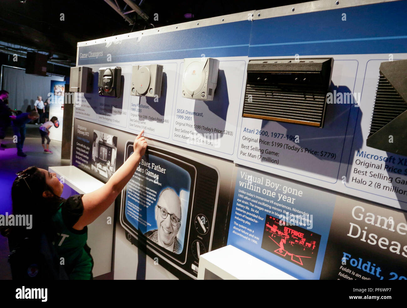 D Virtual Reality Exhibition : Vancouver canada th aug people look at exhibits at the