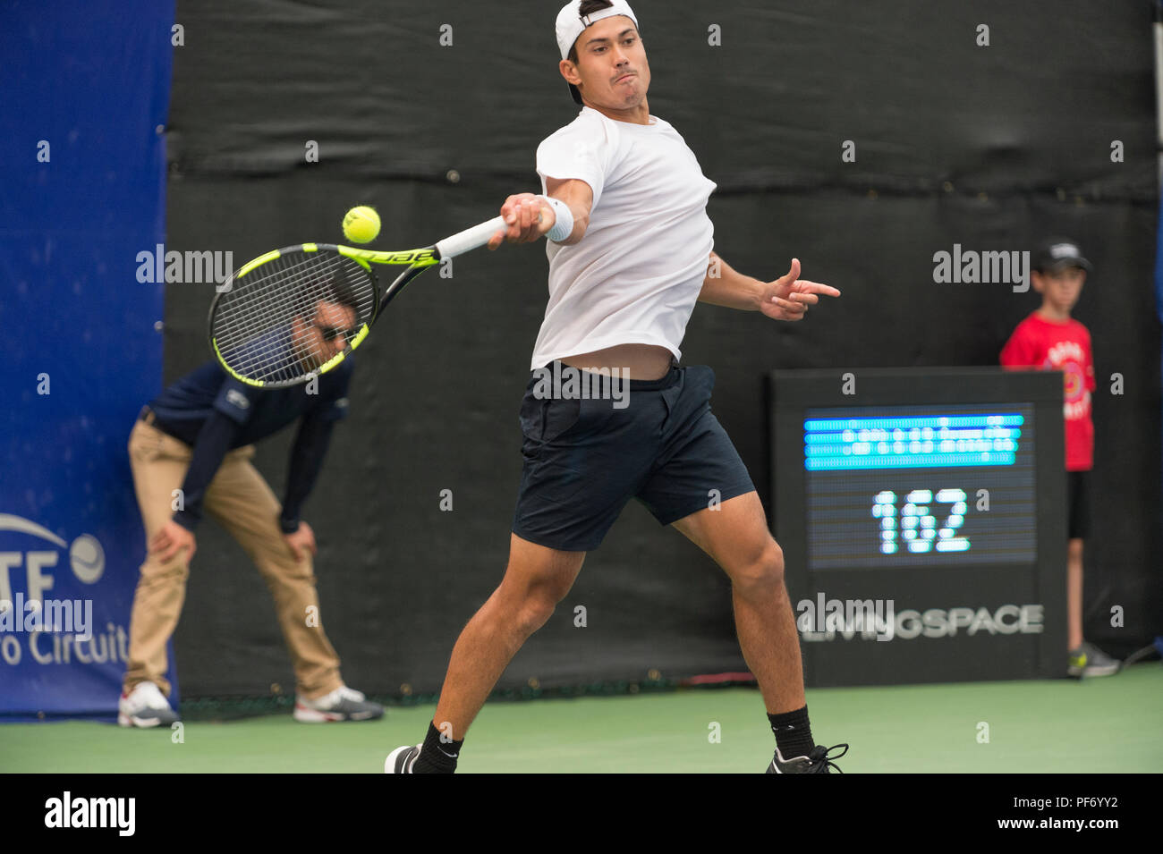 West Vancouver, Canada. 19 August 2018. Jason Kubler of Australia returning a serve, becomes runner up in ATP Challenger Tour Mens Singles Final. Odlum Brown VanOpen. Hollyburn Country Club.  © Gerry Rousseau/Alamy Live News - Stock Image