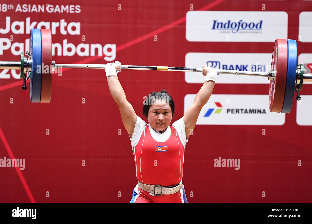 Jakarta, Indonesia. 20th Aug, 2018. Ri Song Gum of the Democratic People's Republic of Korea competes during the women's weightlifting 48kg final at the 18th Asian Games in Jakarta, Indonesia, Aug. 20, 2018. Credit: Li He/Xinhua/Alamy Live News - Stock Image