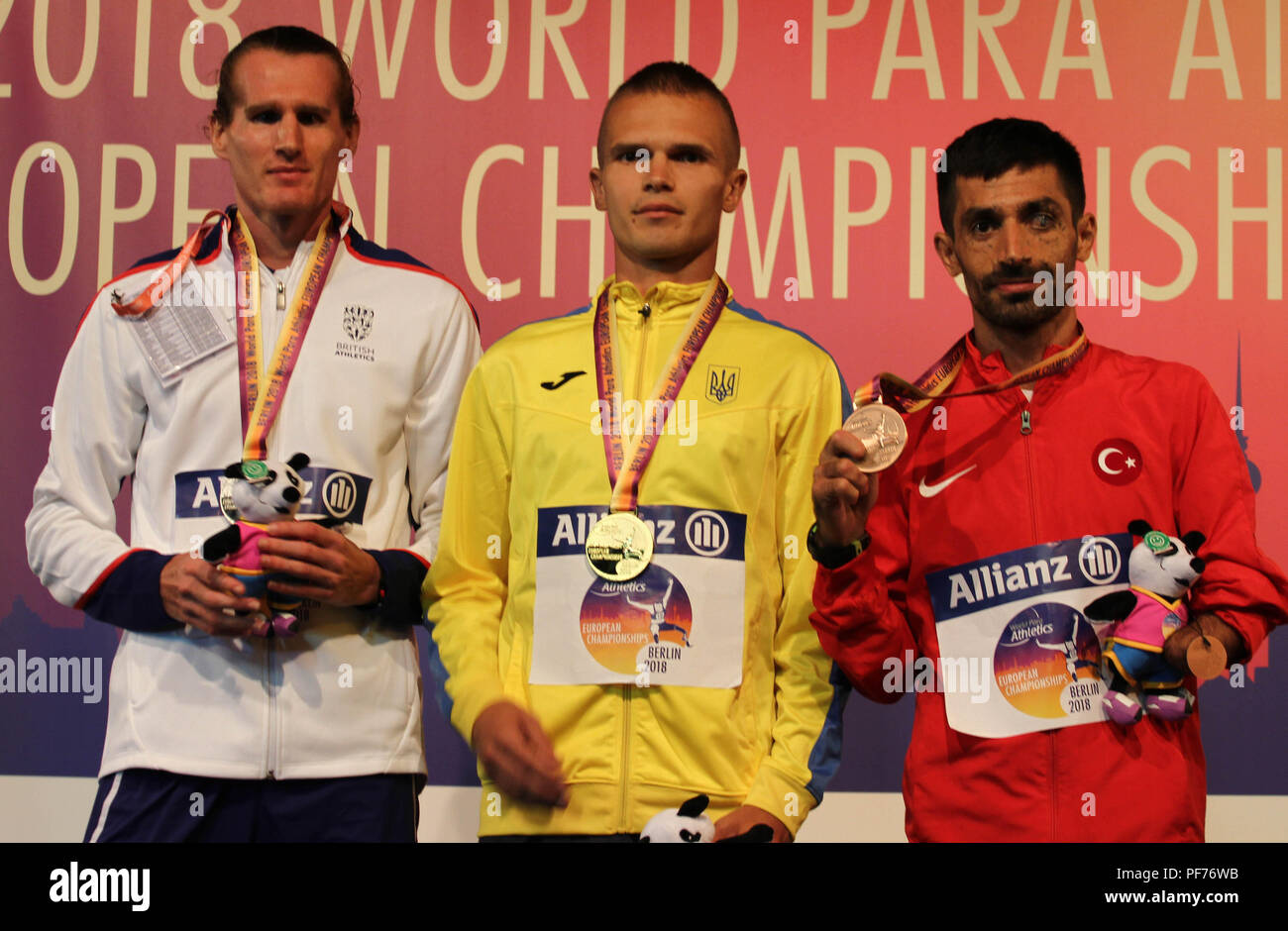 Berlin, Germany. 20th August 2018. David Devine and other athletes pose with their medals on Day 1 of the World Para Athletics European Championships in Berlin, Germany Credit: Ben Booth/Alamy Live News - Stock Image