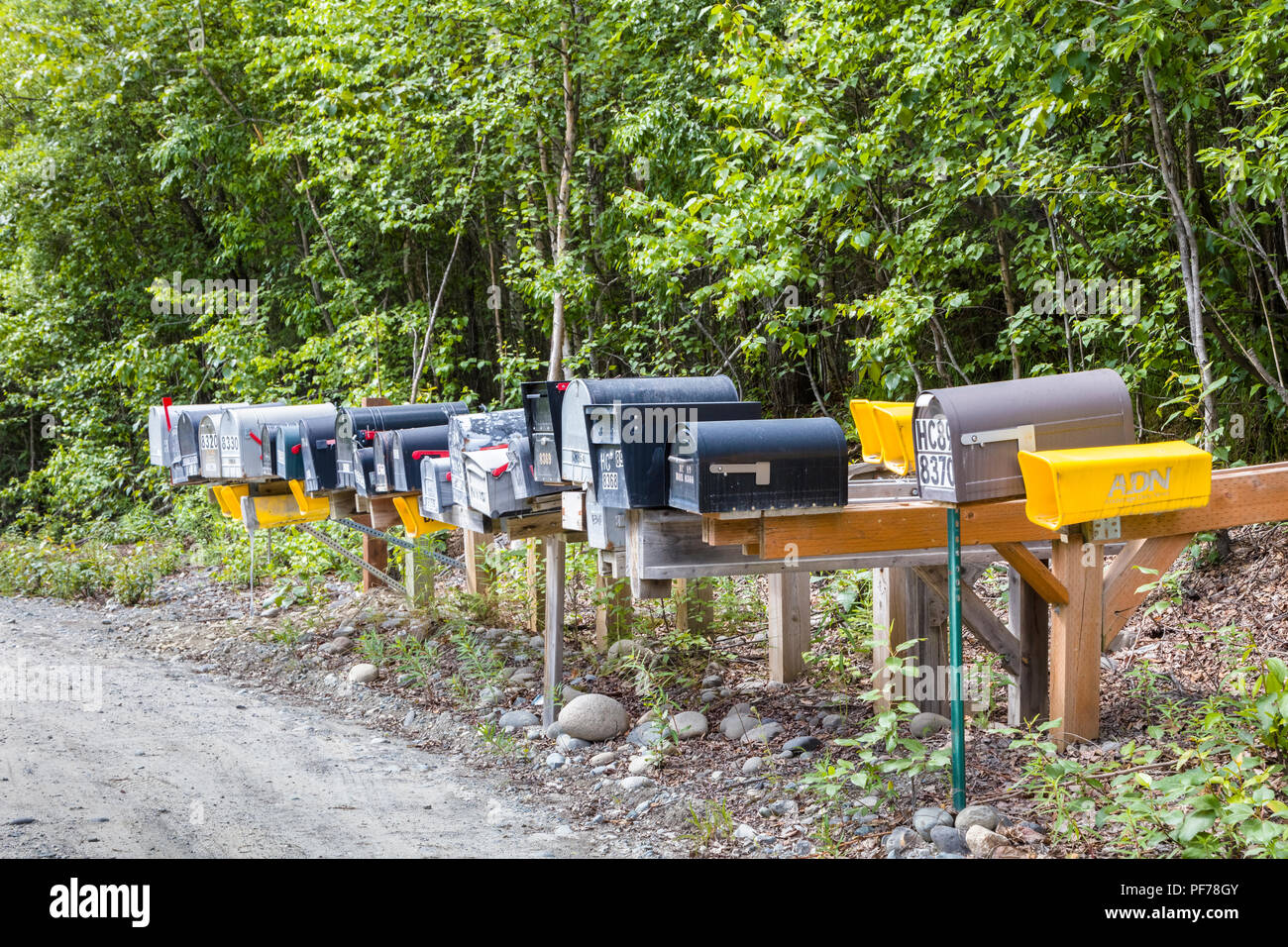 Line of mailboxes along side road Stock Photo