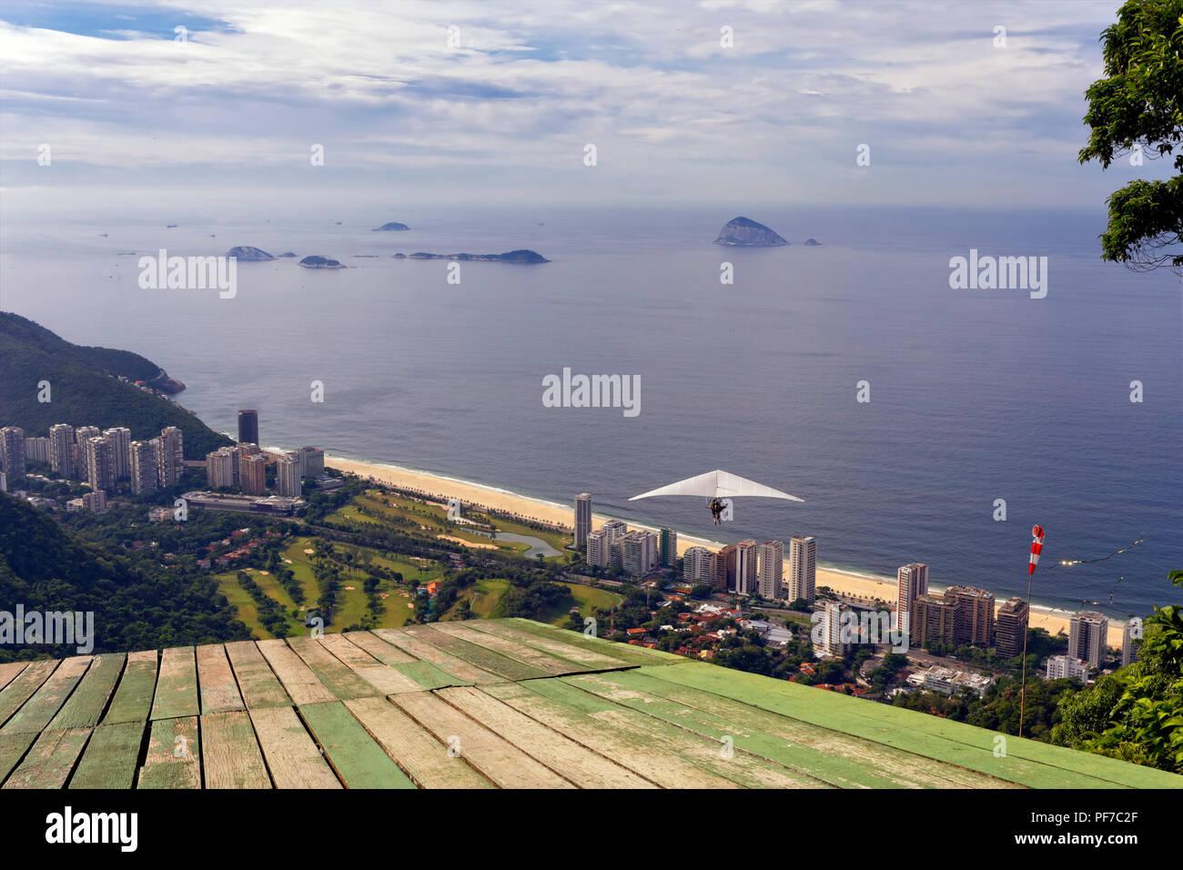 Hang Gliding over Sao Conrado Beach, Rio de Janeiro, Brazil. - Stock Image