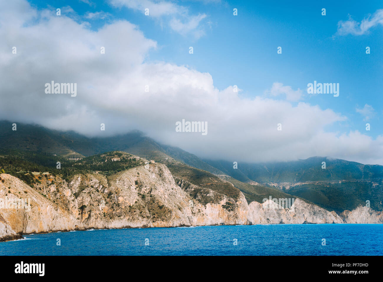 Picturesque rocky coastline on Kefalonia island. Amazing landscape in soft light with cloudscape - Stock Image