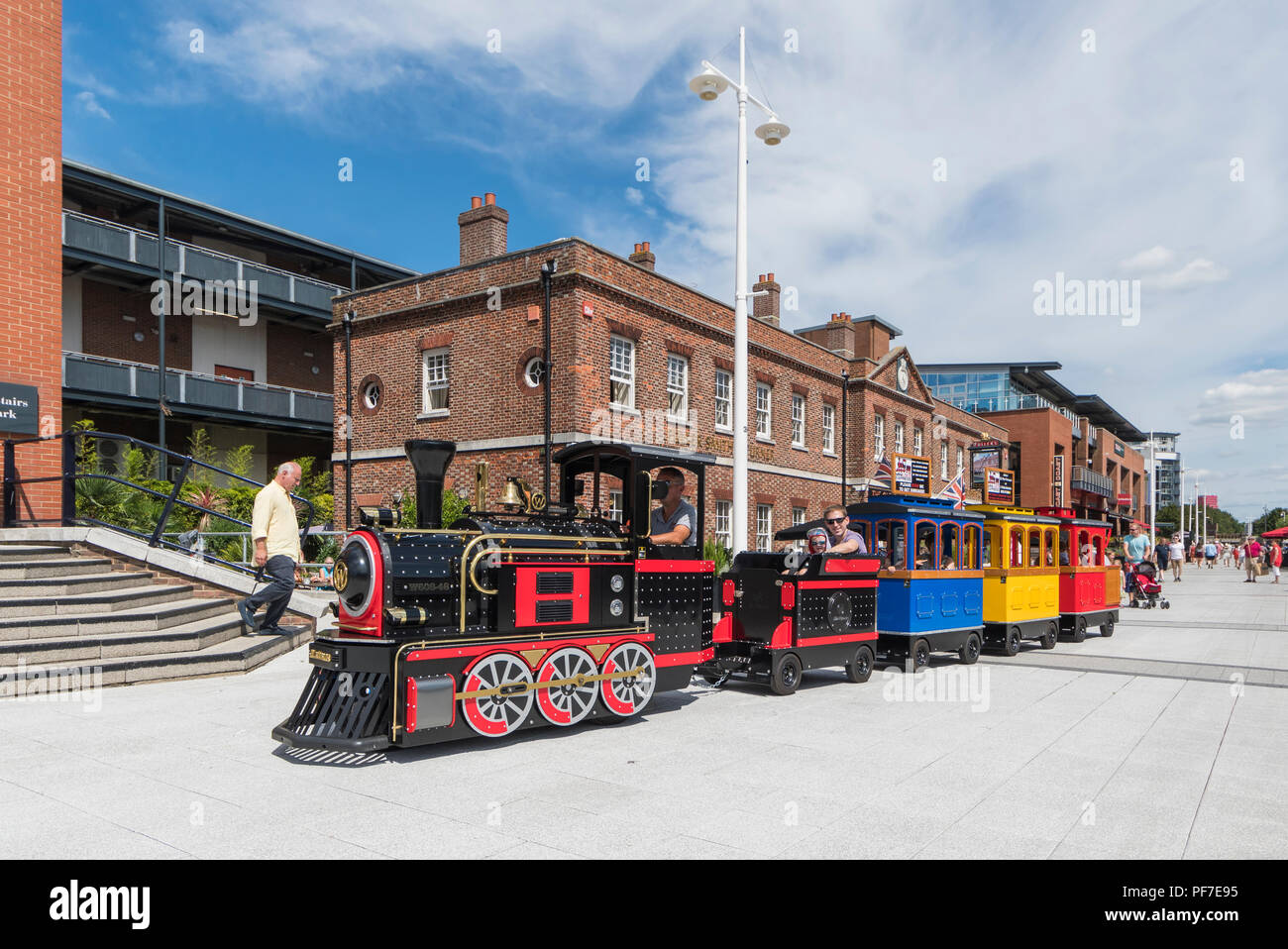 The Mini Loco Express road train in Gunwharf Quays, Portsmouth, Hampshire, England, UK. - Stock Image