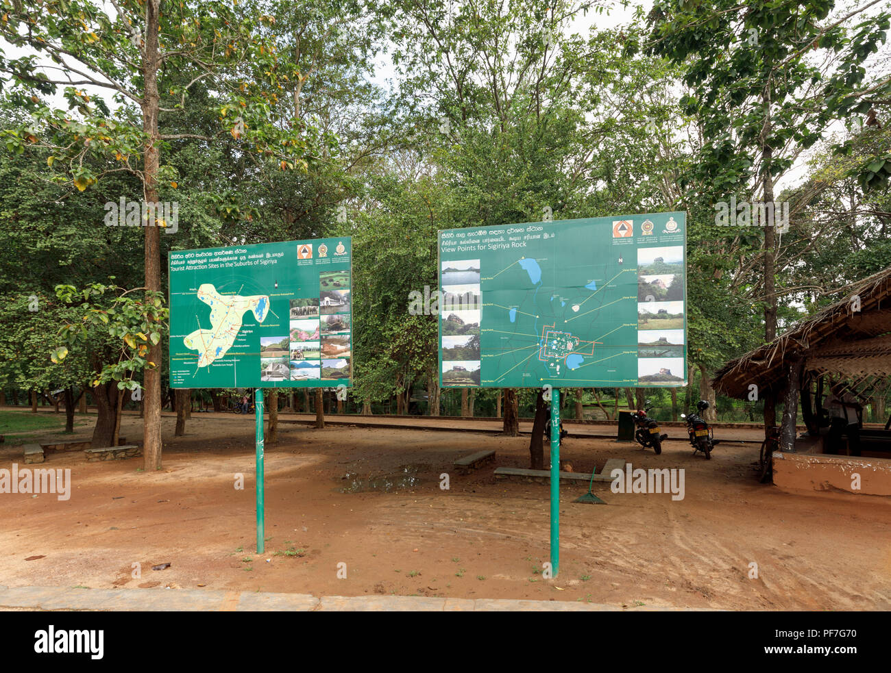 Signs listing points of interest at Sigiriya or Lion Rock in the Cultural Triangle of Sri Lanka, a leading historic monument tourist attraction - Stock Image
