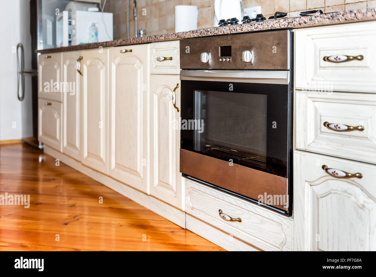 - Modern Wooden Brown Kitchen Features Cabinets With Granite