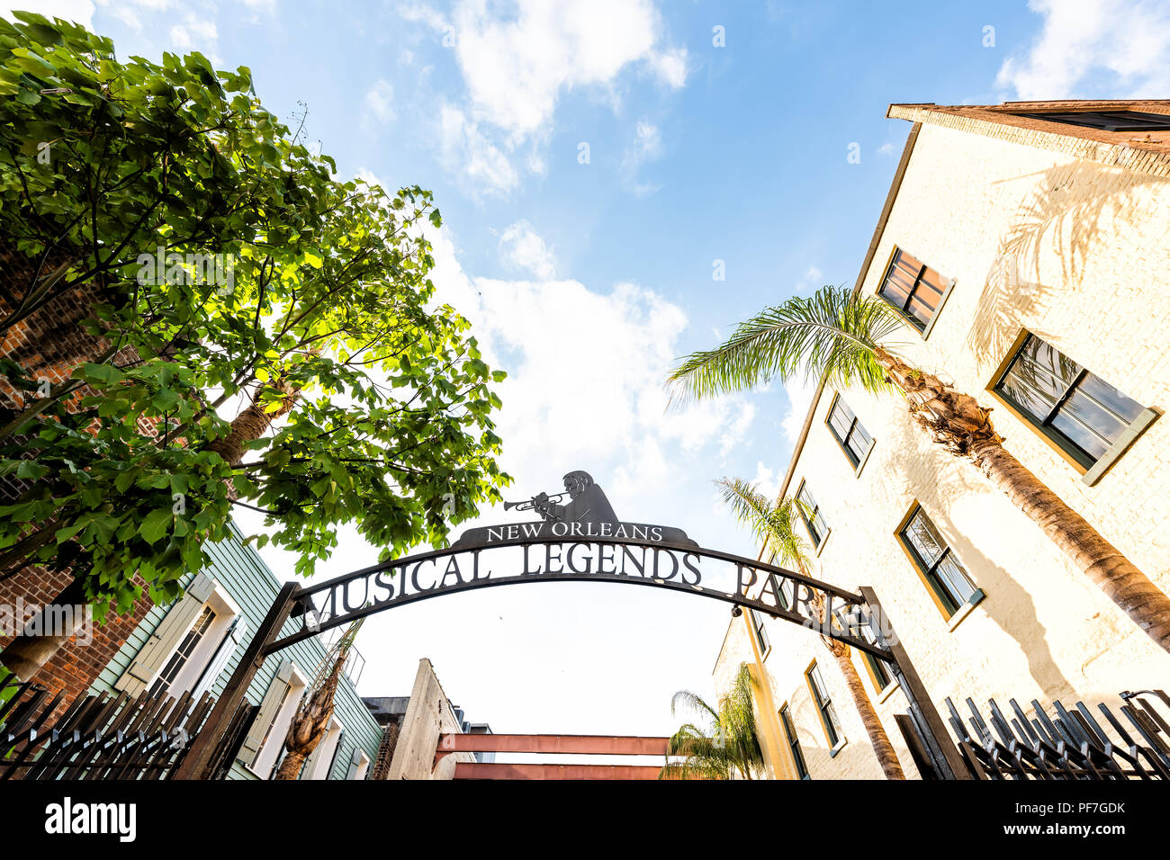 New Orleans, USA - April 23, 2018: Famous jazz music players, the three Greats, on Bourbon Street, French Quarter, Musical Legends Park sign closeup,  - Stock Image