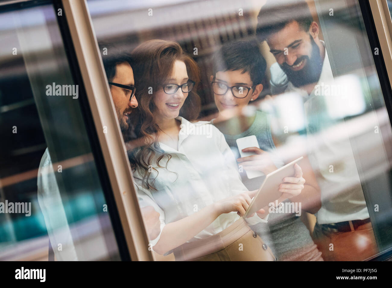 Collaboration and analysis by business people working in office - Stock Image