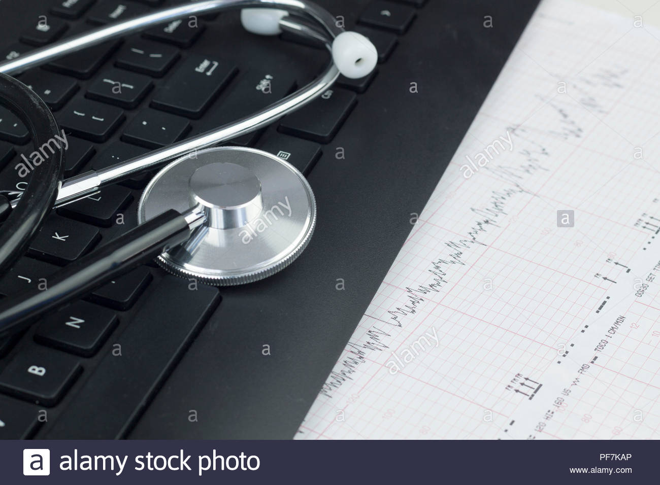 Stethoscope on the keyboard illustrating the medical industry / Medical information concept Stock Photo