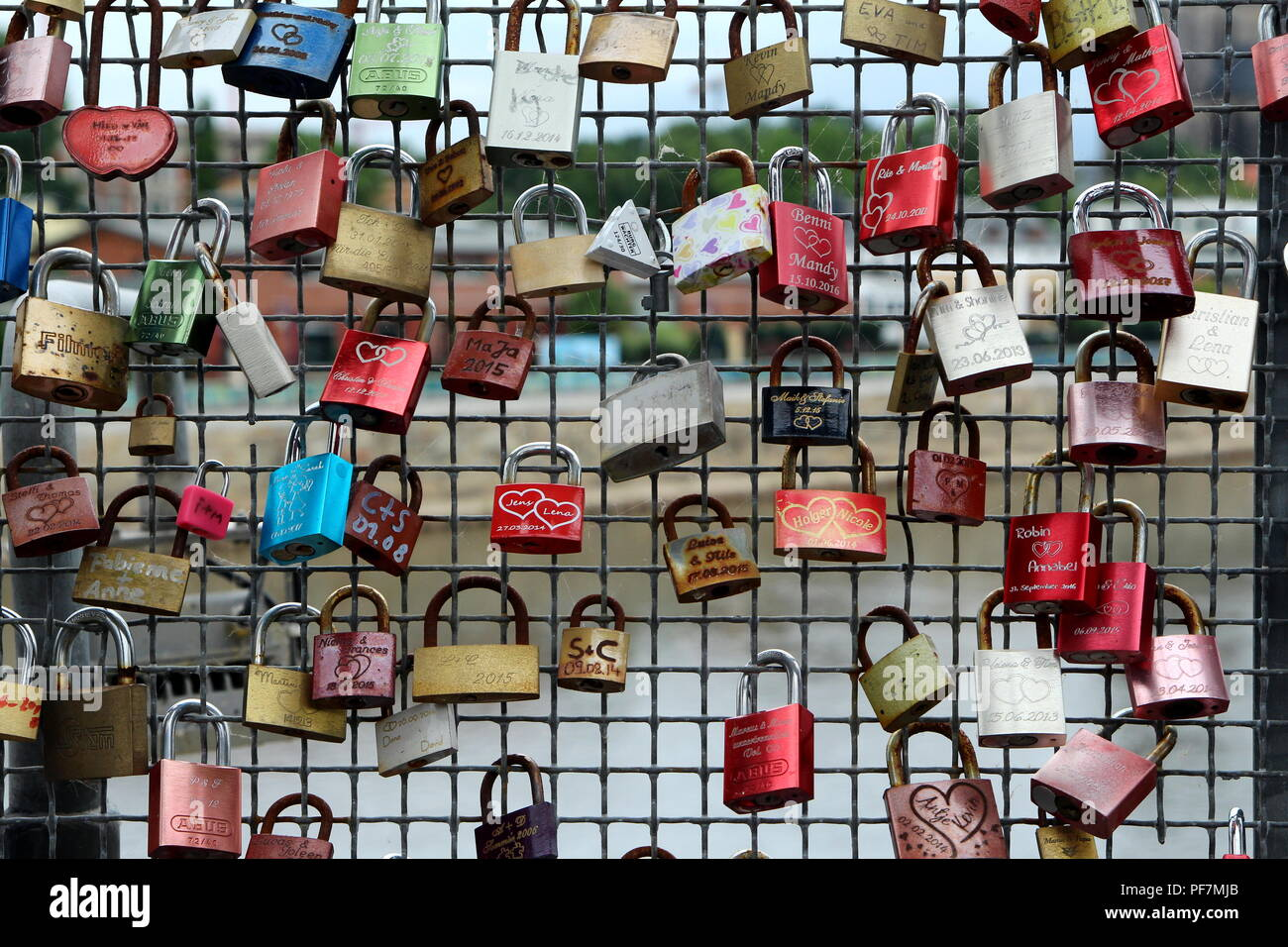 Colorful locks fastened to the bridge. Love forever. - Stock Image