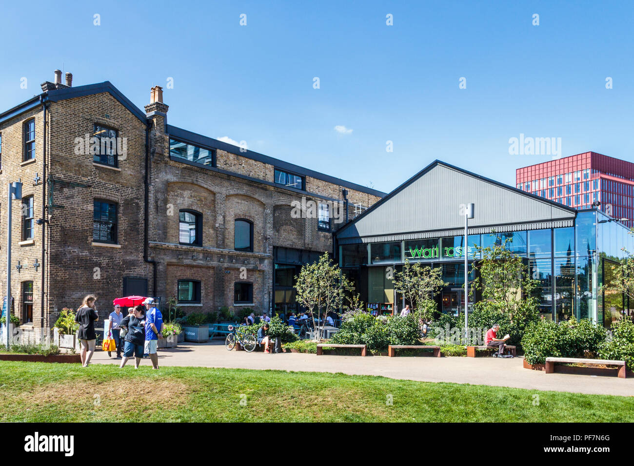 Waitrose supermaket and other recently renovated buildings at Goods Way and Granary Square, King's Cross, London, UK, 2018 - Stock Image