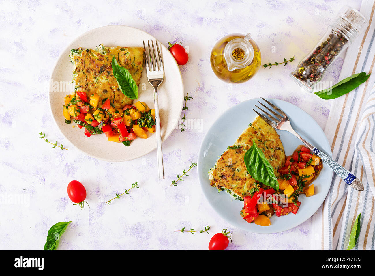 Frittata with zucchini, cheese, basil and salsa from tomatoes. Useful breakfast. Italian omelette. Flat lay. Top view - Stock Image