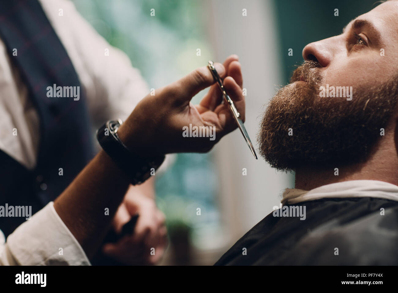 Barbershop concept. Beard model man and barber with scissors. - Stock Image