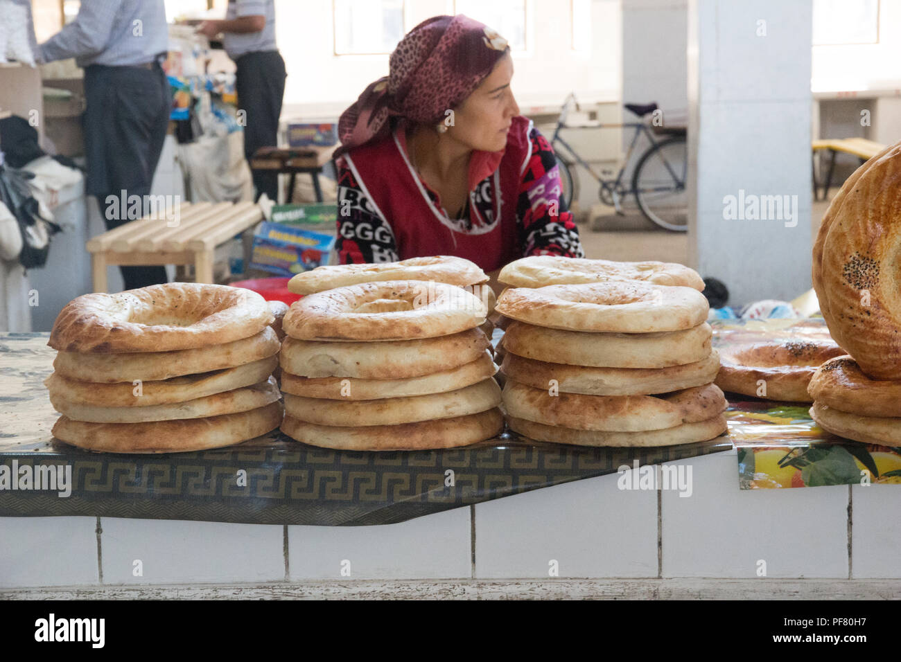 Market sellers selling fresh produce in the food market in city of Bukhara  Uzbekistan, Silk Road, Central Asia - Stock Image