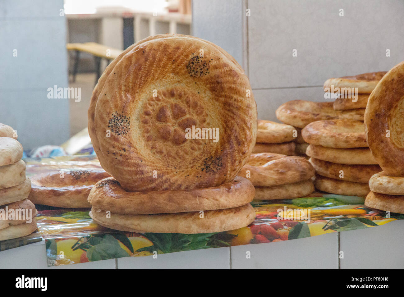 Traditional Non bread  in the food market in city of Bukhara  Uzbekistan, Silk Road, Central Asia - Stock Image