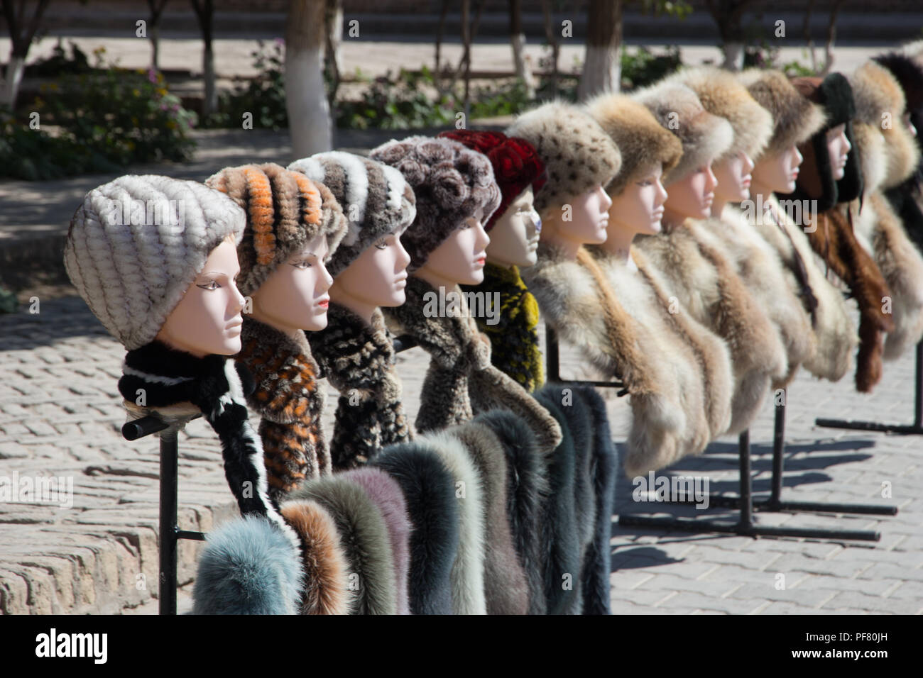 Fur hats on sale in  Khiva, in Khorezm Province, Uzbekistan, Silk Road, Central Asia - Stock Image