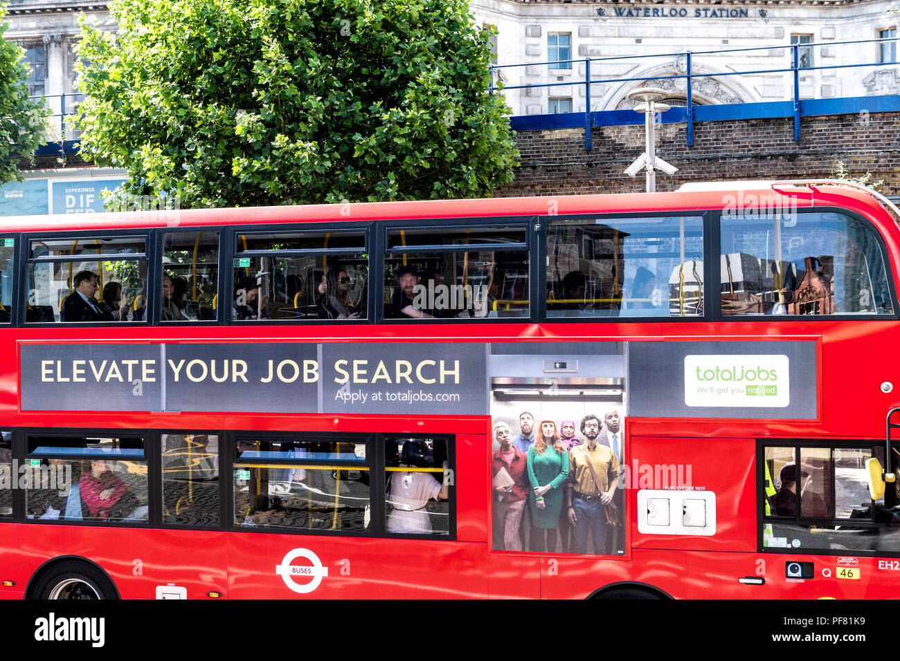 London, UK - June 22, 2018: View on double decker bus in city with ad, advertisement board advertising TotalJobs, online job, work search, recruitment - Stock Image