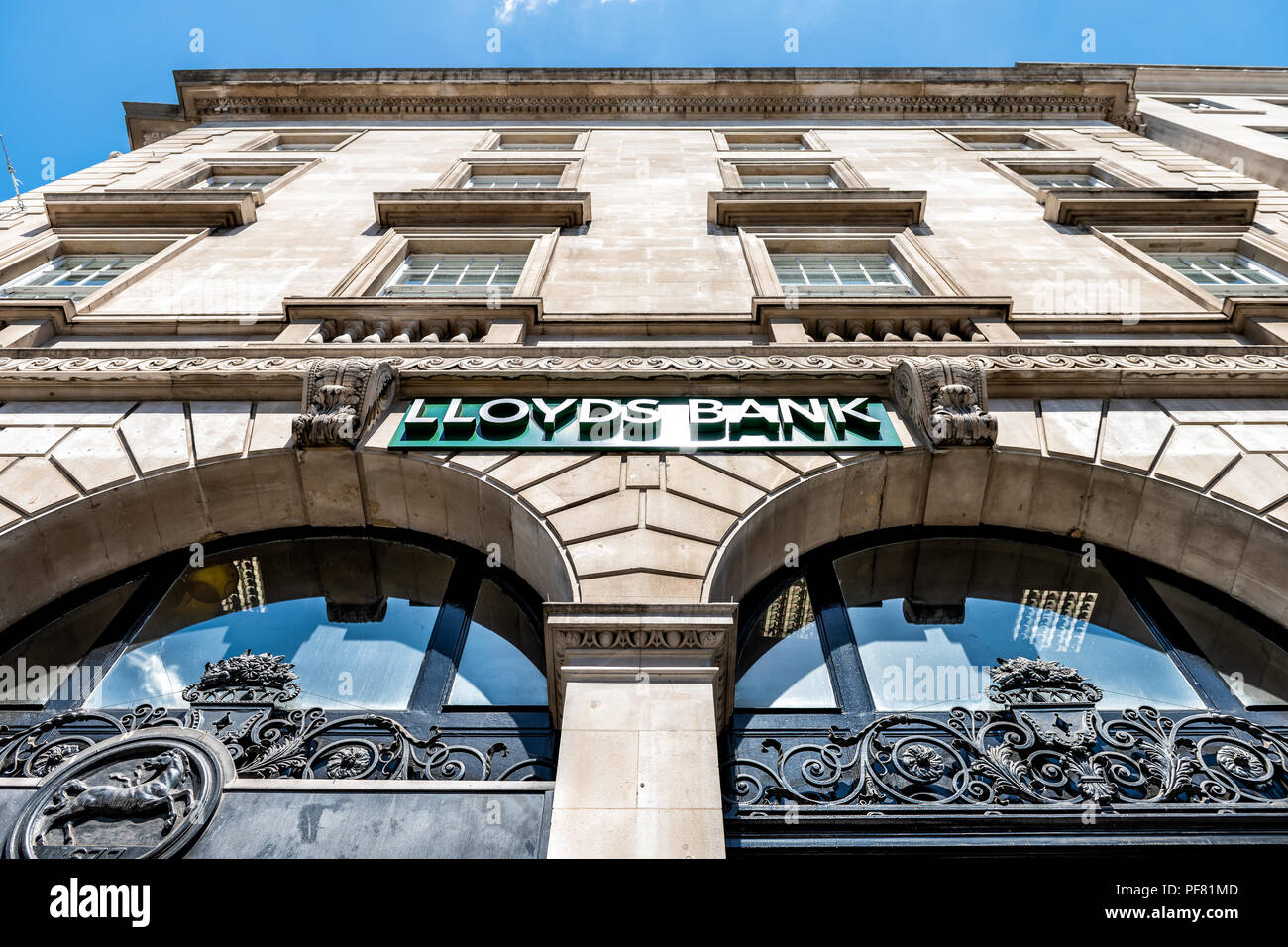 London, UK - June 22, 2018: Low angle, looking up view on Lloyds Bank sign, branch, office in city - Stock Image