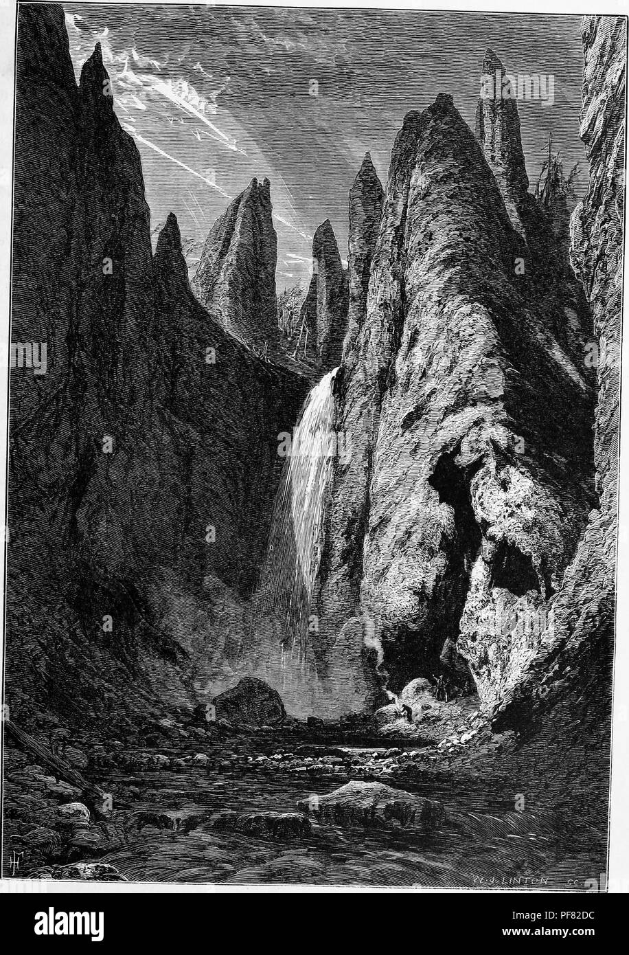 Black and white vintage print depicting a person building a fire in the upper right foreground, with Tower Falls, a waterfall on Tower Creek, located in the northeastern section of Yellowstone National Park, in Wyoming, USA, illustrated by WJ Linton, and published in William Cullen Bryant's edited volume 'Picturesque America; or, The Land We Live In', 1872. Courtesy Internet Archive. () - Stock Image