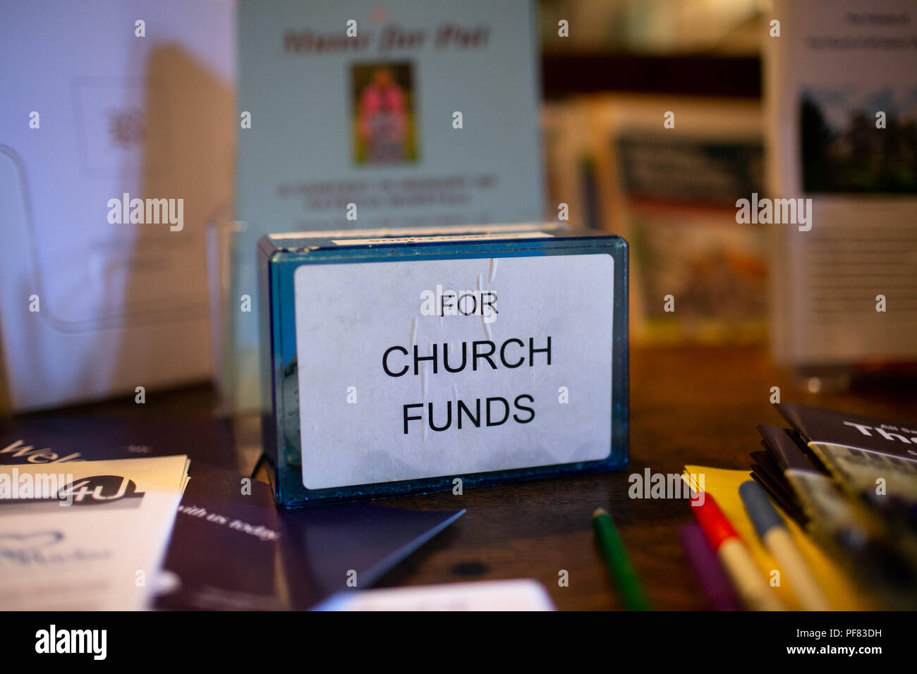Money box for church funds in an english church - Stock Image