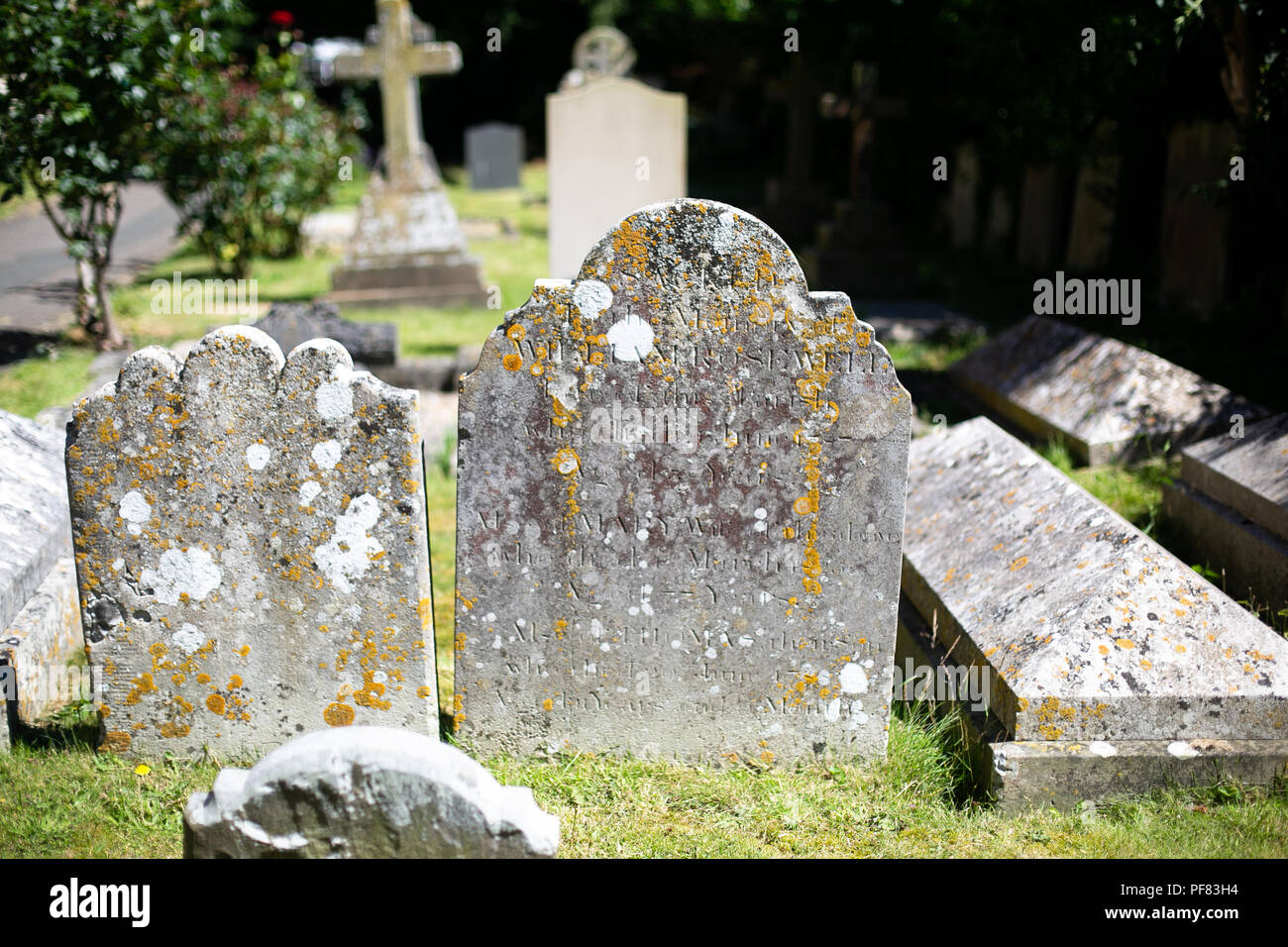Old headstones and graves in an english churchyard - Stock Image