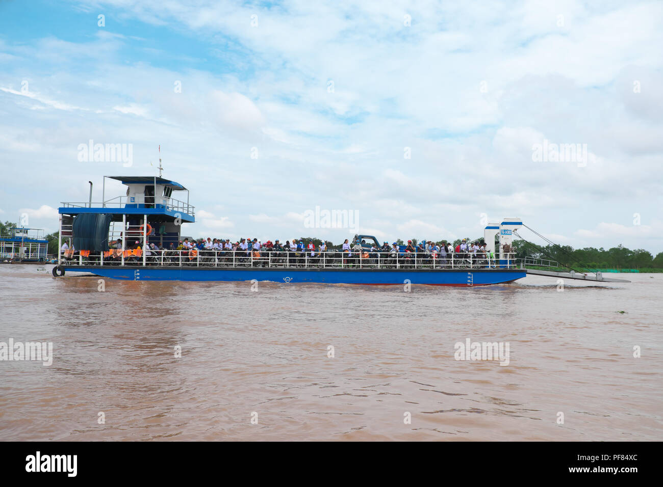 Vietnam Mekong River ferry boat crossing the Mekong Delta waterways heading to Cai Be town Viet Nam - Stock Image