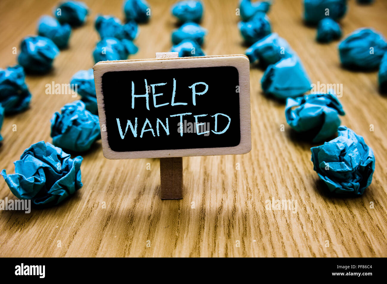 Word writing text Help Wanted. Business concept for advertisement placed in newspaper by employers seek employees Blackboard crumpled papers several t - Stock Image
