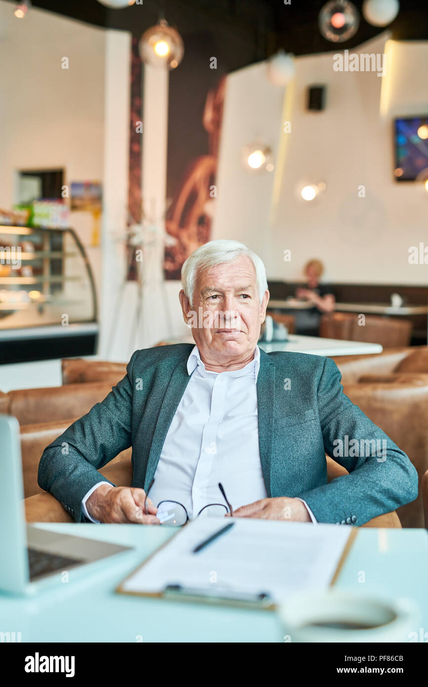 Modern Senior  Businessman Relaxing in Cafe - Stock Image