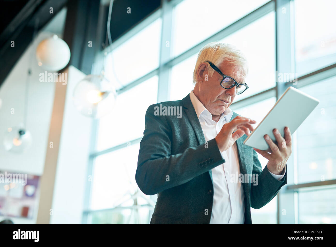 Senior  Businessman Using Tablet - Stock Image