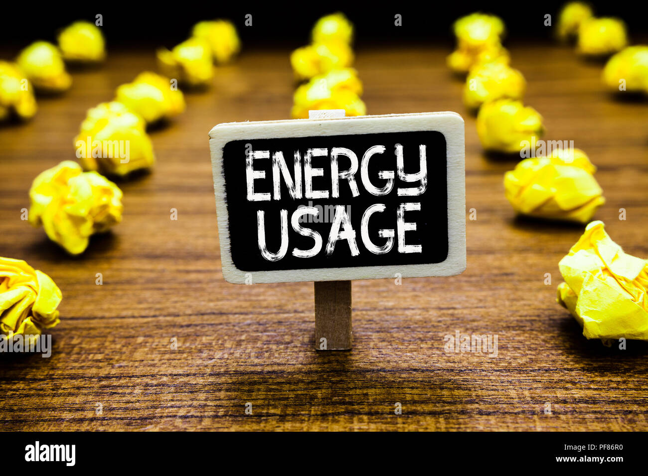 Handwriting text Energy Usage. Concept meaning Amount of energy consumed or used in a process or system Blackboard crumpled papers several tries mista - Stock Image