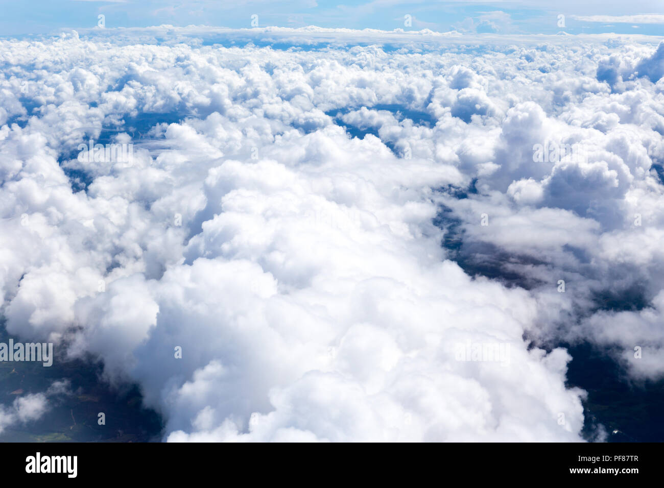 Nature background white clound and blue sky view from airplane windows - Stock Image