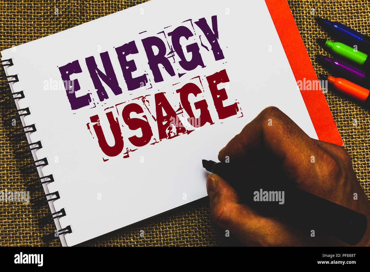 Word writing text Energy Usage. Business concept for Amount of energy consumed or used in a process or system Man hand holding marker notebook paper c - Stock Image