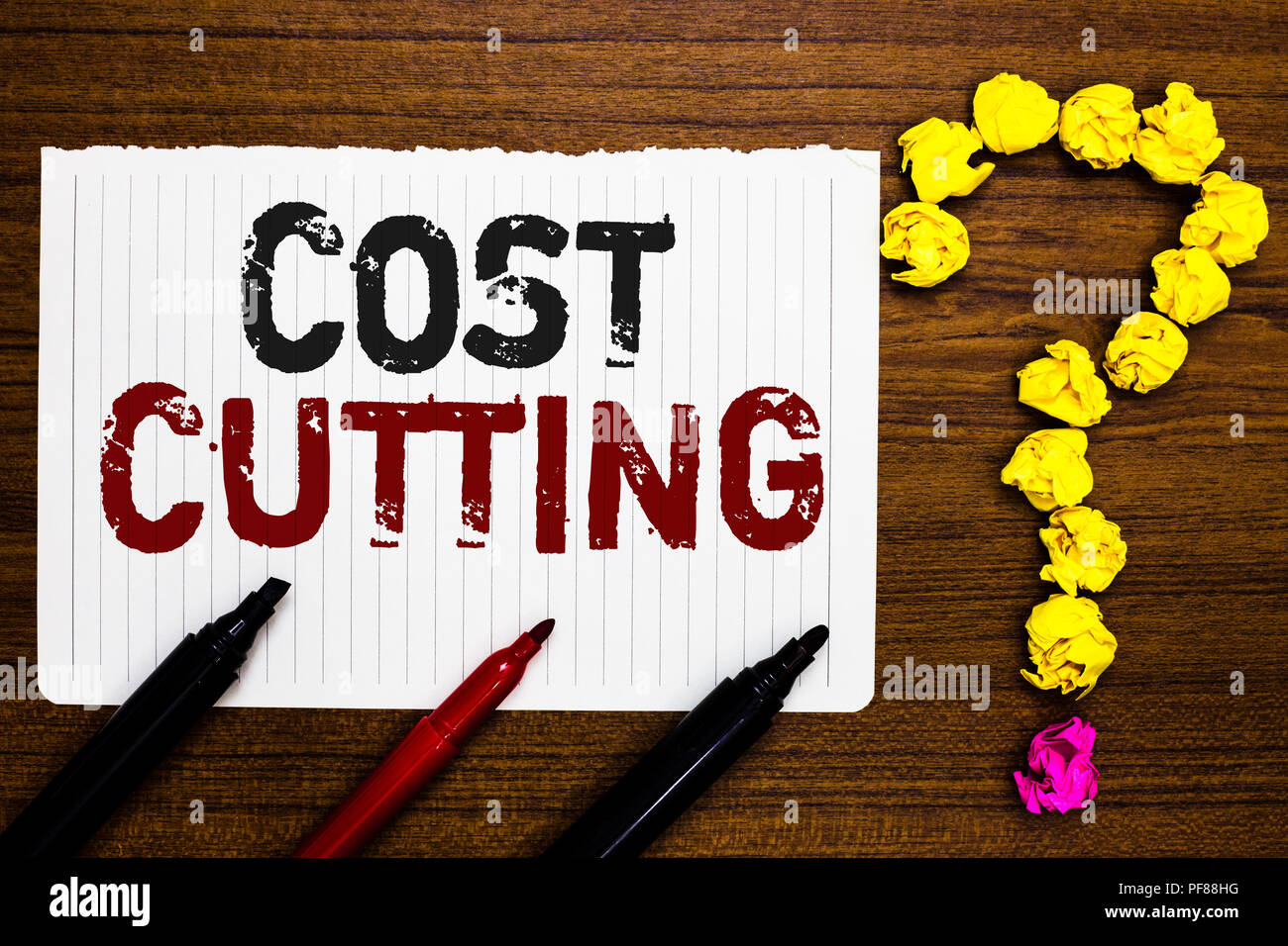 Handwriting text writing Cost Cutting. Concept meaning Measures implemented to reduced expenses and improved profit Paper markers crumpled papers form - Stock Image