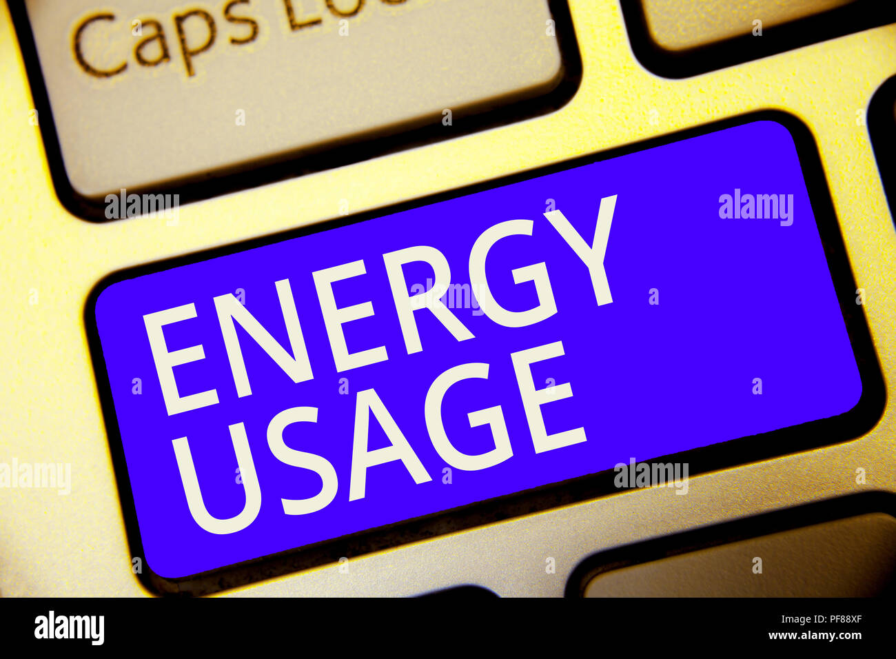 Conceptual hand writing showing Energy Usage. Business photo showcasing Amount of energy consumed or used in a process or system Keyboard blue key Int - Stock Image