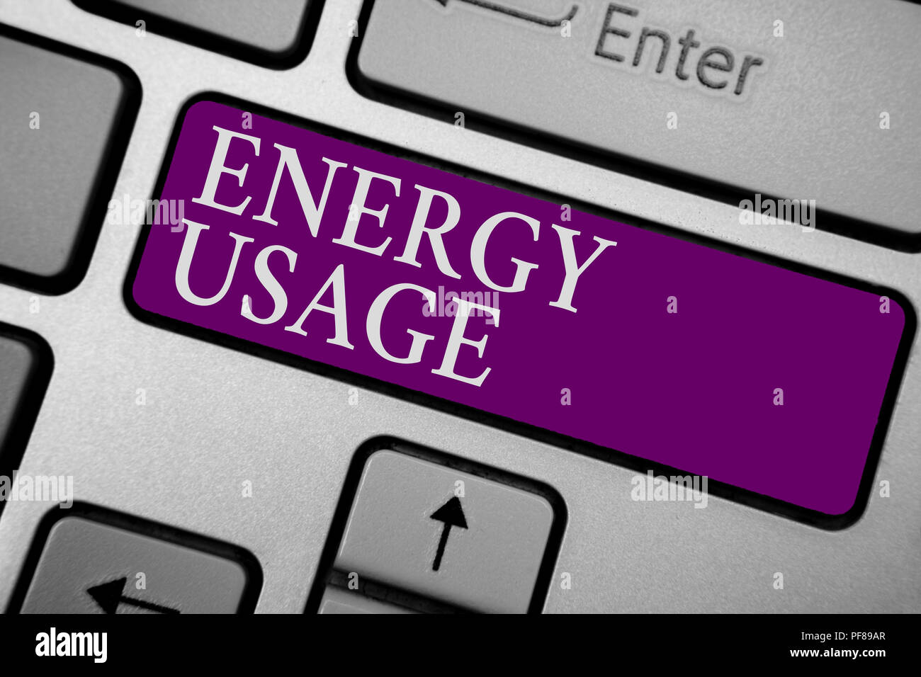 Writing note showing Energy Usage. Business photo showcasing Amount of energy consumed or used in a process or system Keyboard purple key Intention co - Stock Image